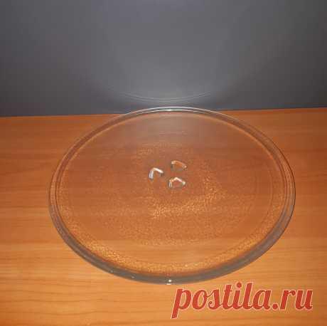 """Поворотный стеклянный стол для микроволновой печи. Диаметр 250 мм.  Диаметр поворотного стола : 250 мм.  На столе имеется надпись : """" 610 For microwave oven only № 09""""."""
