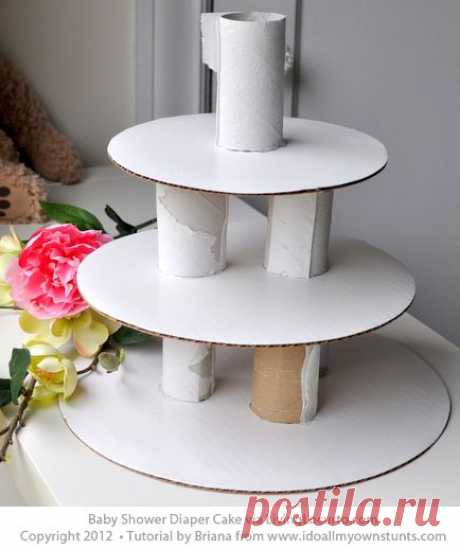 Learn how to make a diaper cake for a baby shower with this easy craft tutorial!