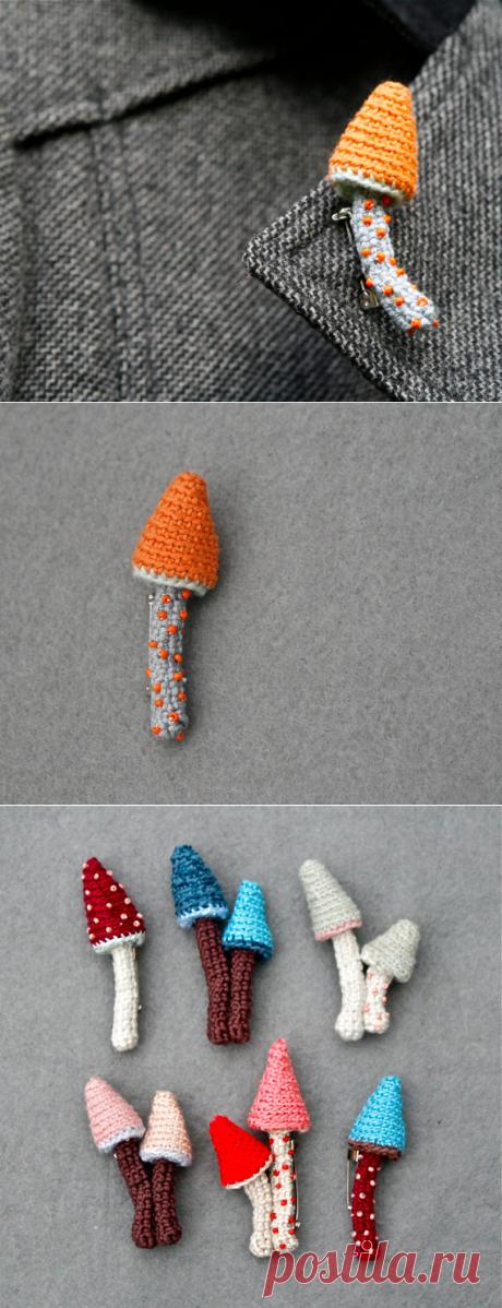 Mushroom crochet brooch in orange and grey