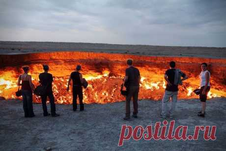 """Darwaz (Gates of hell) – Dashoguz Region, Turkmenistan.\u000d\u000aDarwaz — a gas crater in Turkmenistan. Locals and travelers call it """"Дверь in преисподнюю"""" or """"Врата Ада"""". This Kara Kum crater (diameter - 60 meters, depth - 20 meters) flares several decades violent fire. The origin of this fascinating show is very prosy: in 1971 drilled a prospecting well on gas here and came across an underground cavity. A derrick with everything..."""