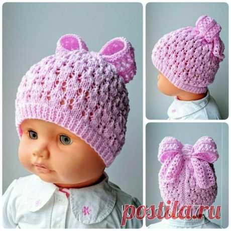 Детская шапочка, связанная ажурной вязкой спицами