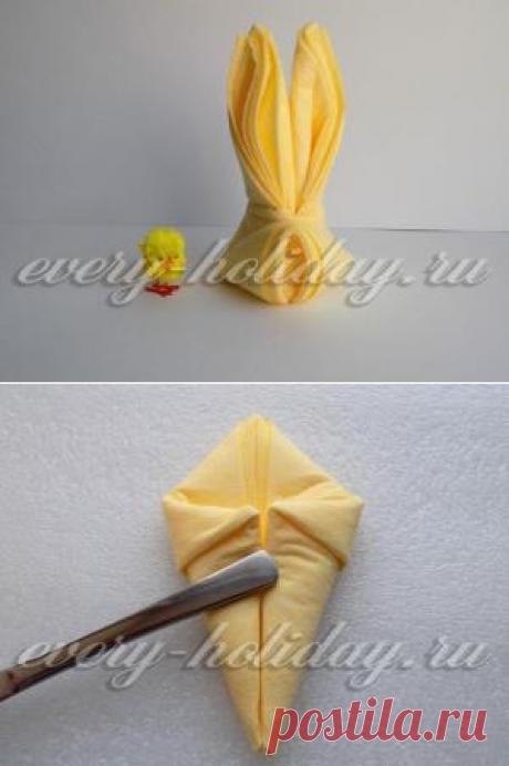 Как сложить салфетку в виде зайца