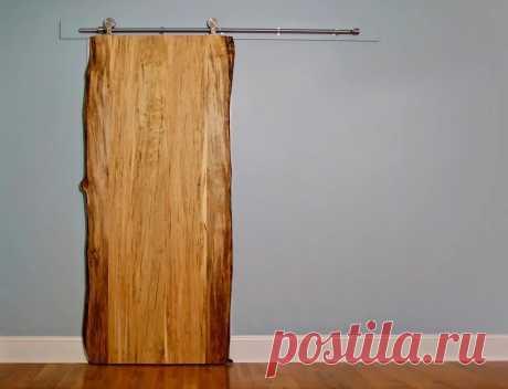 Раздвижная дверь в сарай В последнее время в деревообработке стали популярны изделия из слэба* дерева. Столешницы, стулья, изголовья кроватей, полки и многие другие изделия изготавливают из таки заготовок. Что касается дверей, то двери, как правило, должны закрываться плотно, а слэб имеет неровные края, да и слэб такой