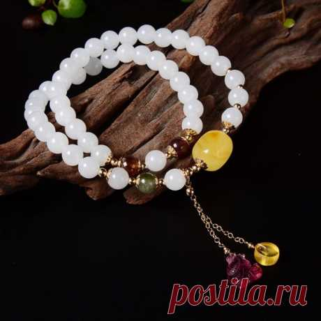 Hetian jade beaded bracelet / 7mm beaded bracelet / beeswax woman bracelet / Buddhist bracelet Product Details:  Material: beeswax, Hetian jade  color: White  Shape: beads  Size: beads 7mm  Weight: 25.1G  Translucent: translucent  Symbol: Good luck to you