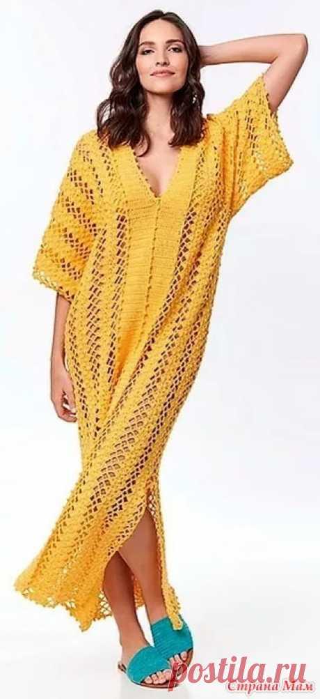 . Пляжное макси-платье Pingouin Bella Wire. Цвет этого пляжного макси-платья прямоугольного силуэта с треугольным вырезом разрезами и свободными короткими рукавами напоминает нам солнечные летние деньки пляж и море.