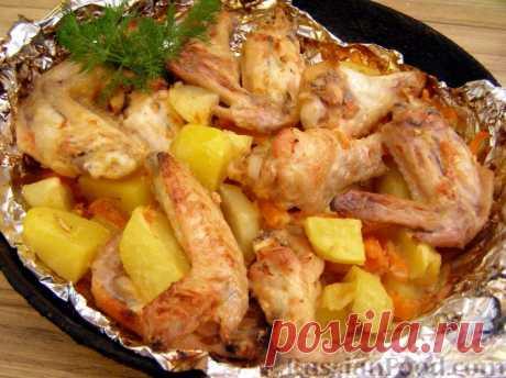 Рецепт: Куриные крылья, запеченные с овощами на RussianFood.com