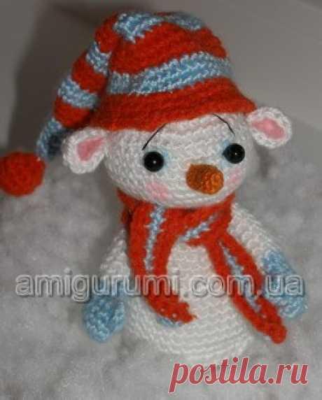 Snowman under a fir-tree