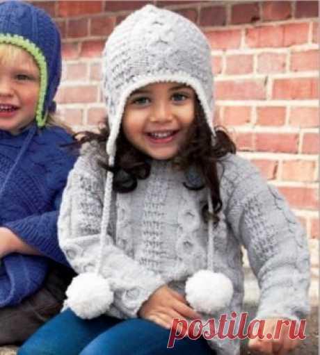 Вяжем комплект для детей из пуловера и шапочки Теплый детский комплект из связанного спицами пуловера и шапки с ушками обязательно понадобится вашему ребенку в прохладные дни. Вязаные детские вещи должны быть не только теплыми, а также удобными и красивыми.
