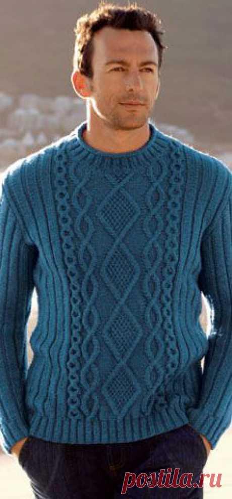 Синий джемпер с косами иромбами Не только красивый, но теплый и уютный мужской джемпер связан спицами.