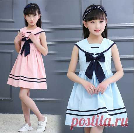 El vestido infantil en el estilo de mar. Las dimensiones: del año a 14 años (la Costura y el corte)