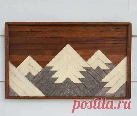 Handmade wooden wall art and mountain decor. This mountain range wall decor, of rustic, geometric and mosaic design, has 5 mountain peaks in a 20 wide by 12 inch tall space. From smooth textured reclaimed wood lath and weathered barn wood, each a one of a kind piece. It would make