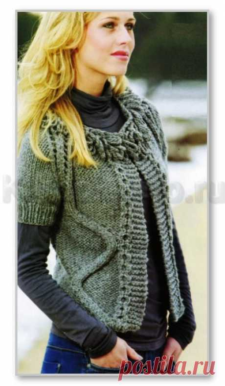 Knitting by spokes. Female models. The shortened jacket with short sleeves, a fringe from the extended loops, with a volume pattern the Snake. Size: 34-52