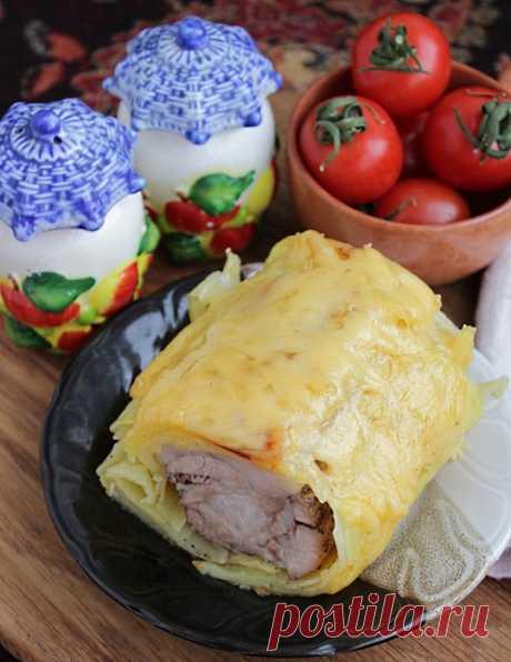 Мясо свинины запеченное в картофеле с сырной корочкой