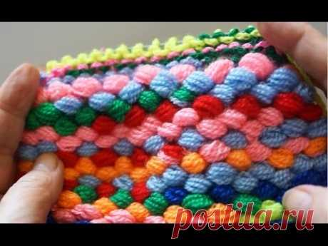 Rug from a self-made pomponny yarn (mat homemade yarn pom-poms)