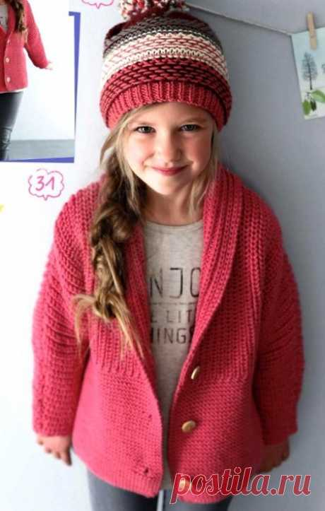 Knitting by spokes of a children's jacket and cap