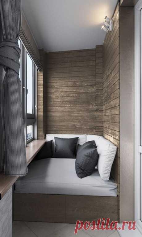 Современная лоджия со встроенным угловым диваном