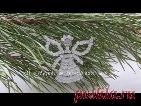 Weaving by beads. An angel on a fir-tree. Christmas decoration. Beadwork.