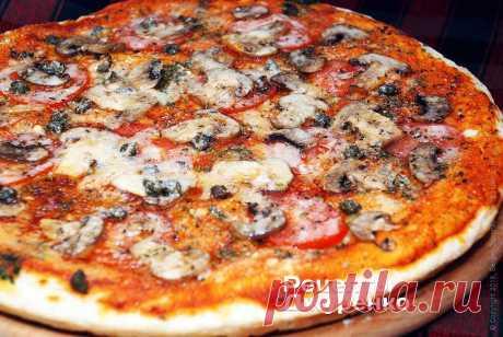 La pizza con los champiñones