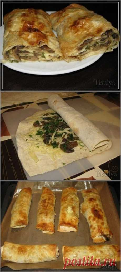 Mushroom roll from an unleavened wheat cake