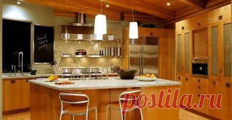 Кухня из массива     Кухня из массива со столом посередине     Просторная кухня, где можно не только приготовить еду, но и развлечь своих гостей. Интерьер Дизайнеры разместили  два светильника над столом посередине кухни, чтобы создать более интимную атмосферу.