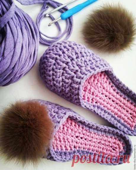 In a moneybox of fans of knitting. Slippers from a knitted yarn.