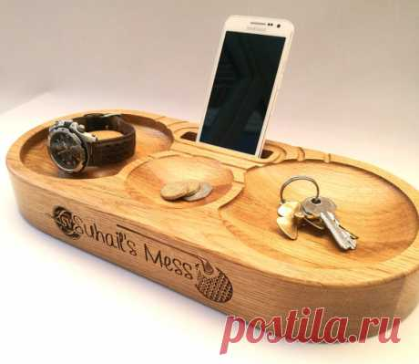 Phone Stand, Charging Station. Triple bowls,watch stand. Personalised. Solid oak with cable route for charger. Superb Fathers Day present! Phone stand in oak. Charging Station which includes three bowls for change, wallet, keys etc. The left hand bowl also includes a watch stand post. Superb Gift for Him and Fathers Day (the one in the gallery was created for a keen golfer, for example)  Dimensions: 365mm x 160mm x 50mm