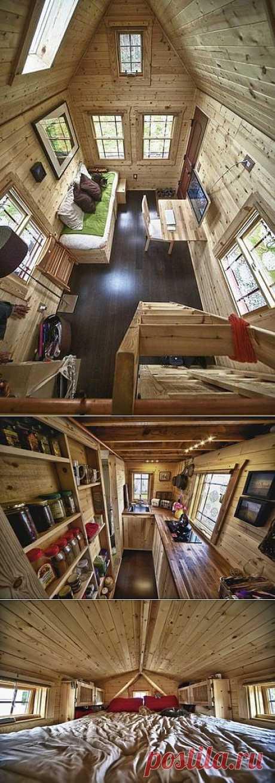 Миниатюрный домик (всего 18 кв.м.) со всем необходимым для жизни. Отличная идея для маленького дачного участка.