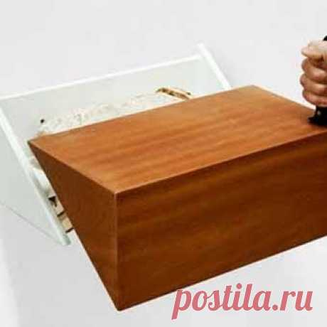 the suspended wooden bread box easily turns.