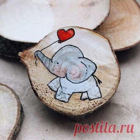 Забавные рисунки на деревянных спилах