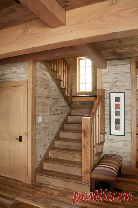 Even the simplicity of this staircase has a way of highlighting the many characteristics of the timber frame hybrid style with the reclaimed flooring and barn boards used for walls.