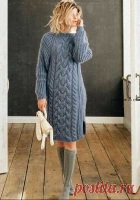 Warm dress spokes with a pattern a royal braid. A winter dress for women with schemes