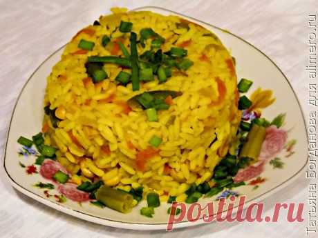 Rice with vegetables on a frying pan