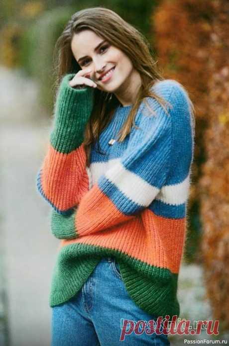 Оерсайз джемпер полупатентным узором спицами Зеленый, оранжевый, синий и белый - многоцветное сочетание горизонтальных полос разной ширины сразу привлекает внимание. Очень яркий и заметный пуловер связан полупатентной резинкой в две нити из двух видов прекрасной пряжи: одна состоит из мохера с шелком, вторая из шерсти мериноса с...
