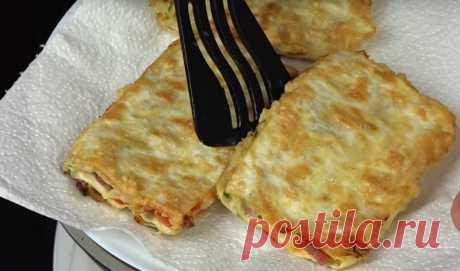 Невероятно вкусная закуска из лаваша Ингредиенты Лаваш по вкусу Сыр плавленый 200 грамм Колбаса варено-копченая сервелат 250 грамм Томат (помидор) 200 грамм Чеснок 1 зубчик 5 грамм Укроп 50