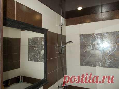 Маленькая уютная ванная комната и плитка не дорогая. Удачно сделали дизайн