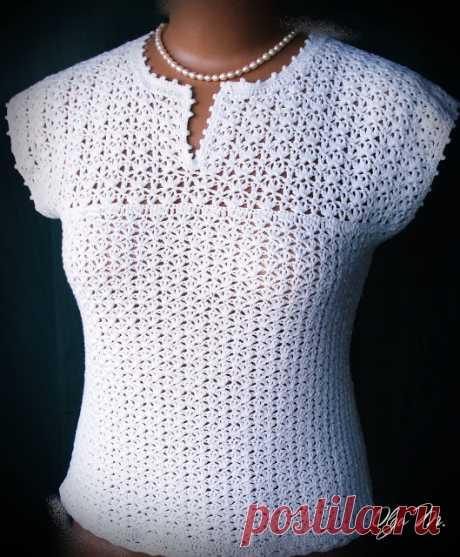 La blusa blanco como la nieve veraniega. El gancho.