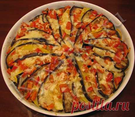 Eggplants casserole with potato, tomatoes and a mozzarella