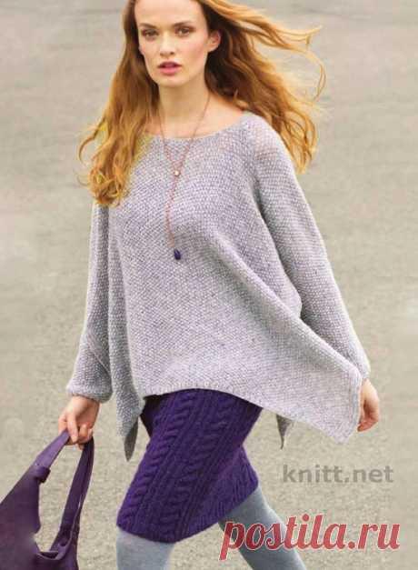 Вязаные пуловер-пончо и лиловая юбка.