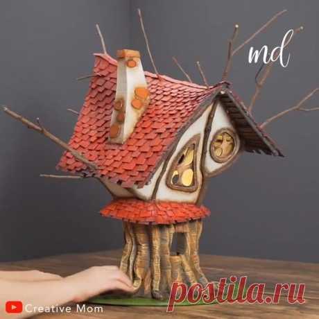 A fairytale-like treehouse made of cardboard & forest twigs!