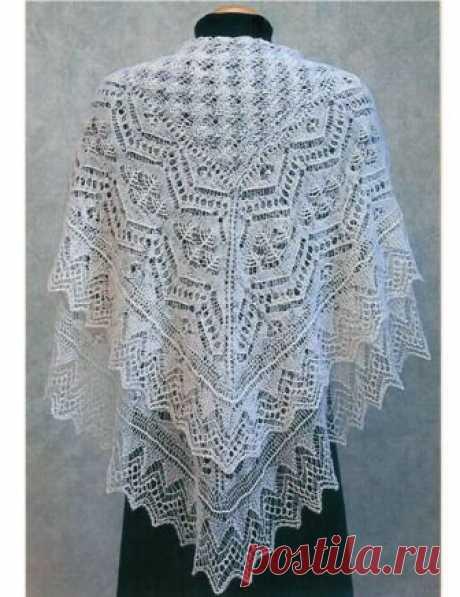 Красивая ажурная шаль спицами Тина Красивая ажурная шаль спицами Красивая ажурная шаль в стиле традиционных шетландских кружев вяжется спицами по схемам.