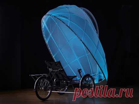всепогодный велосипед с откинутым верхом