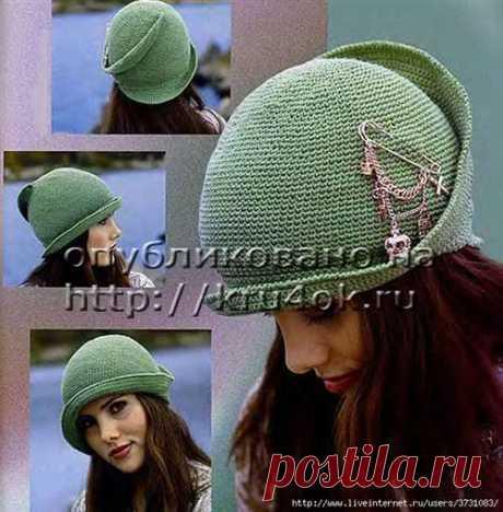 Элегантная зеленая шляпка необычной формы