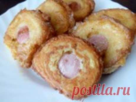 Сосиски в картопляному пюре.