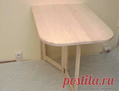 Folding table for small kitchen. The hands.