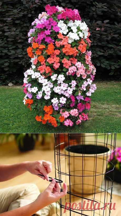 Оригинальная клумба для цветов - башня из петуний.