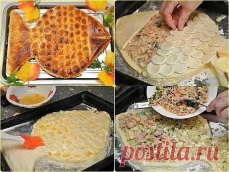 """ПИРОГ """"ЗОЛОТАЯ РЫБКА"""" Aроматный горячий рыбный пирог, приготовленный своими руками, ваши домашние оценят на ура. Потому что это очень вкусно. Приятного аппетита! Ингредиенты: ● 2 банки рыбных консервов (у нас форель), ● 0,5 стакана риса, ● 2 сваренных вкрутую яйца, ● 1 луковица, ● 2 пачки (1000 г) готового слоеного бездрожжевого теста, ● 50 г сливочного масла, ● соль, перец, ● яйцо для смазывания. Приготовление: Рис отварить почти до готовности, лучше немного не доварить. Промыть, чтобы он с"""
