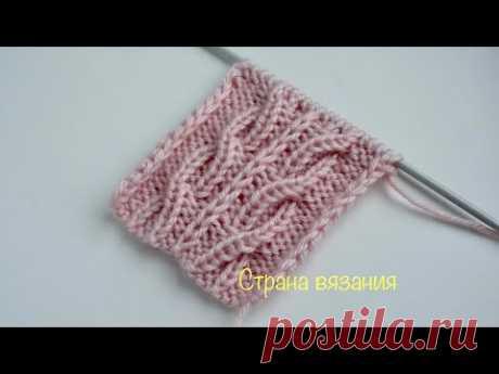 Узоры спицами. Коса со снятой петлей. Knitting patterns. The braid with the loop removed.