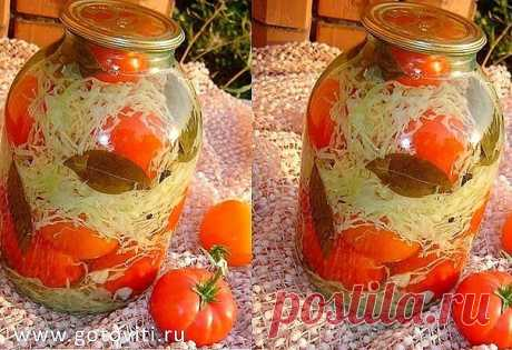 TOMATOES WITH CABBAGE. TRY, IT WILL BE PLEASANT TO YOU!\u000d\u000aTo chop cabbage, to grate carrots, to cut small bolg. pepper to crush garlic. To mix everything. In the sterilized banks 3-liter. On a bottom, laurels. leaf, pepper of souls. mountains., 2 umbrellas of fennel. We stack tomatoes, pouring each layer the chopped vegetables. To fill in from above with the boiling brine. To sterilize 15 minutes. To roll up. To wrap up.\u000d\u000aBrine:\u000d\u000aOn 1 liter of water,\u000d\u000a2 Art. of beds of salt,\u000d\u000a3 Art. of beds of sugar,\u000d\u000a1 h spoon of 9% of vinegar