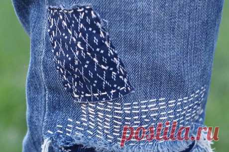 Fashionable way: close up holes on jeans in the Japanese technician Boro