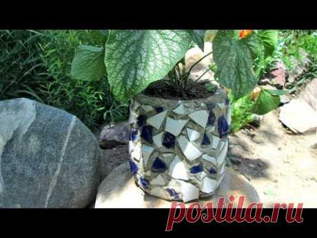 Flowerpot for flowers from cement with a mosaic for a garden